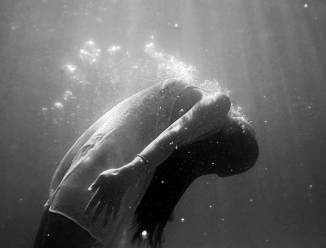 floating woman via unsplash.com